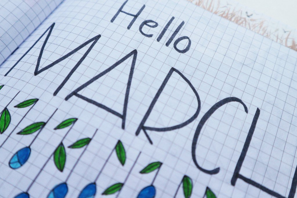 hello-march-printed-paper-on-white-surface-910193-1.jpg